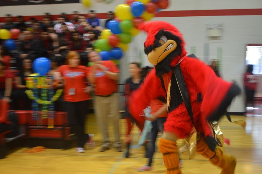 Junior+Samuel+Ferguson+enters+the+gym+at+the+homecoming+pep+rally+as+the+school+mascot+flappng+his+wings+in+order+to+pump+up+the+crowd.