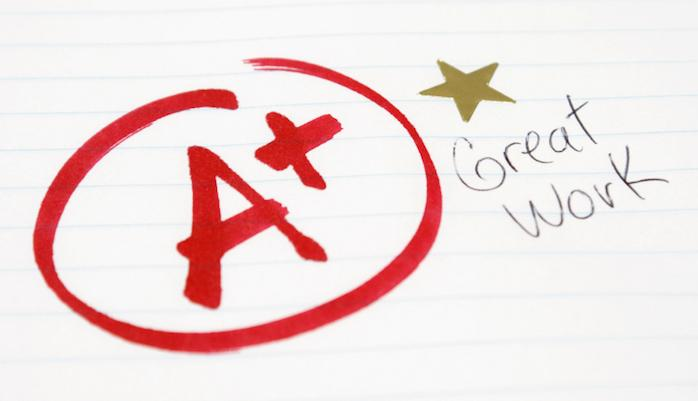 An+A+plus+is+given+to+a+student+for+great+work+being+achieved.