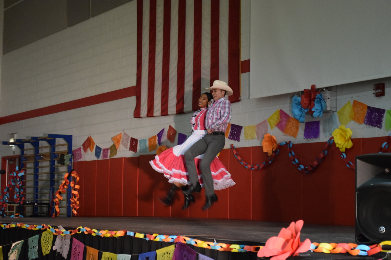 Cultural Pride. Dancing with her partner, senior Nallely Sanchez performs at the annual Heritage Day Fiesta.  Sanchez has been competing in Folkloric dance for 12 years.