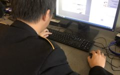 Senior Alvin Du works on one of the new computers in Mr. McElgunn's room.