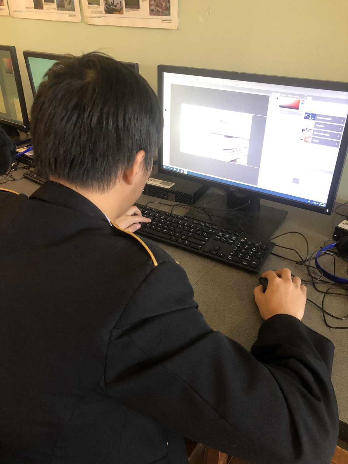 Senior Alvin Du works on one of the new computers in Mr. McElgunn